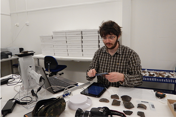 Figure 1: Me using the pXRF to take a reading from a ceramic sherd